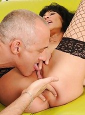 Brunette granny is toying sucking and  fucking