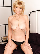 Skinny granny Irene is fucking with a younger cock