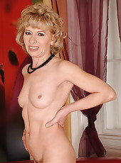 Hairy mom in black stockings fucked by young guy