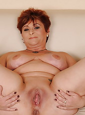 Impish granny in a fucking and anal fingering act
