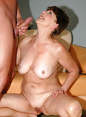 Brunette happy grandma sucking huge wet sausage