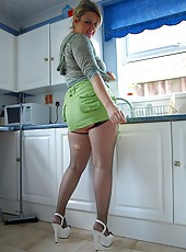 Slutty housewife Daniella in mini skirt and fishnet stockings cleans up her kitchen