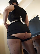 Daniella dressed as a slutty maid in seamed polka dot stockings