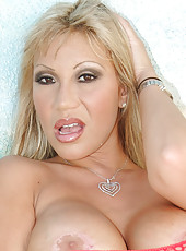 How do you think I look as a blond in my red mesh outfit, hot,