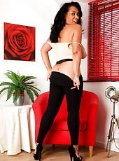 Danica Collins in tight leggings, heels and no bra