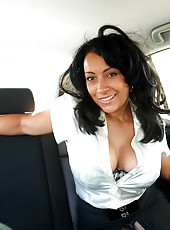 Danica strips in the back seat of a taxi