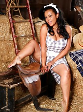 Danica strips in the barn for a quick wank