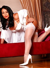 Pinup babe Danica in white lingerie, stockings and heels