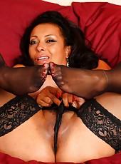 Danica sucks and fucks her dildo in black stockings and lingerie