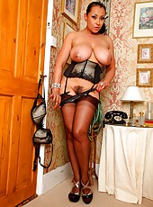 Danica in stockings and corset after an evening out.