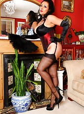 Lady Danica in silk stockings, silk corset and satin gloves.