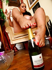 Danica enjoys cold champagne on her stockinged and bare feet.