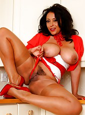 Danica in stockings and heels pulls down her panties to masturbate.