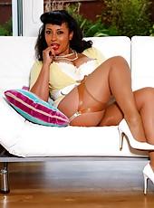Danica Collins slips off her panties to masturbate on the sofa