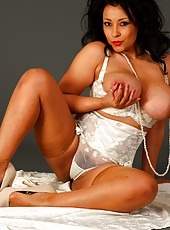 Danica Collins in stockings and soft cream lace lingerie