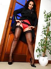 Danica Collins with a sexy treat hidden under her coat