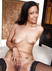 Horny brunette pilot Julie Ann spreading her shaven pussy wings