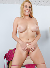 40 year old Jennifer Best in pink lingerie spreading her tiny little pussy