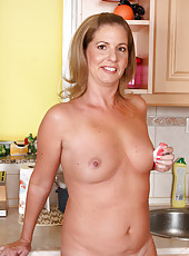 40 year old Laura G works up a naked lather while fooling in the kitchen