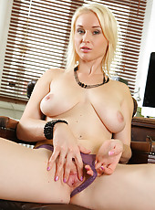 Blonde and beautiful MILF Sherry Riiley stuffs a glass dildo deep