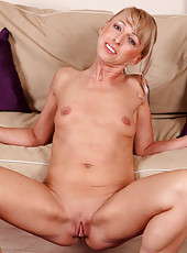 Blonde and elegant Elizabeth M spreads her tight mature ass open