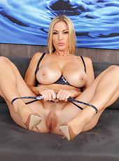 Hot blonde MILF Carol plunges a glass dildo deep inside her pussy