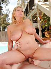 Blonde and busty Tahnee Taylor takes a sucking and fucking hard cock