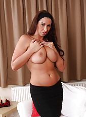 Busty brunette Lisa Sparkle plunges her fingers deep into her pussy