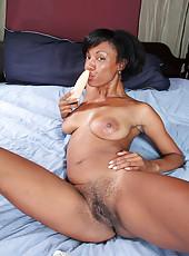 Horny Jayden from AllOver30 slips her dildo deep inside her pussy