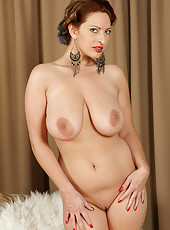 Elegant and busty Salinas from AllOver30 spreads her shaven pussy