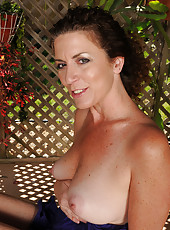 46 year old Tammy Sue gets naked in the backyard and spreads wide