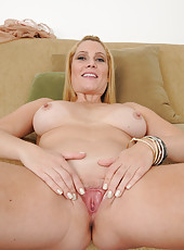 Sexy and elegant Jennifer Best strips and spreads her tiny pussy