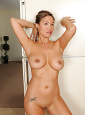 Exotic housewife Trish strps naked in front of her fridge in here