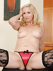 57 year old Annabelle from AllOver30 looking sexy in her black stockings