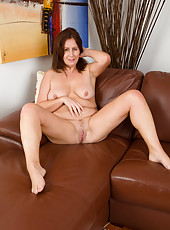 Gorgeous 47 year old Carol Foxwell massaging her mature pussy