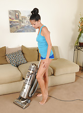 Mature brunette housewife Hailey Murphy puts on a strip show here