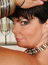 Elegant 33 year old Brooklyn Rain slips off her evening dress and spreads