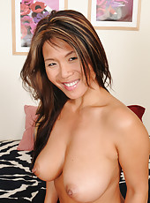 Exotic Trisha from AllOver30 slips out of her tight sexy orange lingerie