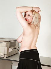 Busty blonde 35 year old Brenda strips and pulls at her meaty pussy