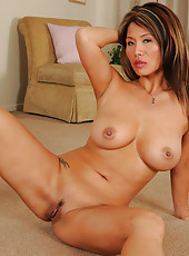 Exotic and elegant 38 year old Trisha spreading her long dark legs here