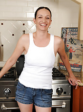 Pale housewife Beth M from AllOver30 opens up her legs in the kitchen