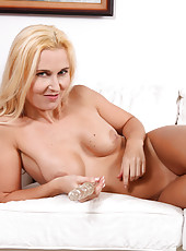Elegant cougar Caroline enjoys a beaded glass toy deep in her milf hole