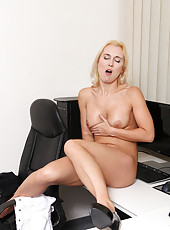 Cock starved executive fondles her juice dripping pussy at her desk