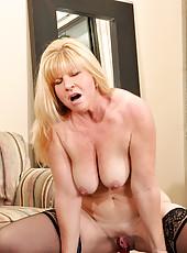 Sex craving busty milf fucks a long dildo on a mirror