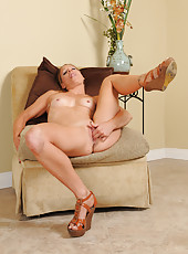 Small breasted housewife Alyssa Dutch slips her fingers deep inside