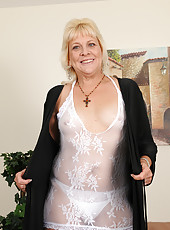 52 year old housewife Sindy Silver slips off her sexy white lingerie