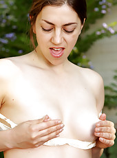 Furry pussied housewife Silva Storey from AllOver30 stripping outside