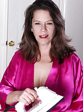 43 year old and busty MILF Christy takes a break from ironing clothes