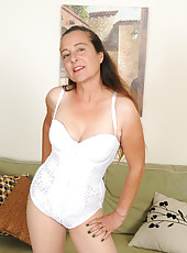 Long haired housewife Nicola from AllOver30 slips off her white lingerie