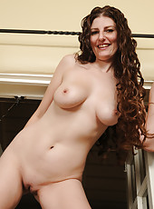 Long haired housewife Sabrina Deep  strips and spreads her pussy